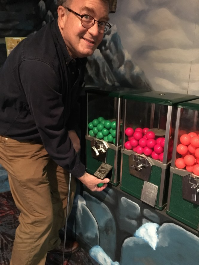 My Dad getting a green ball from these awesome coin-op vending machines.