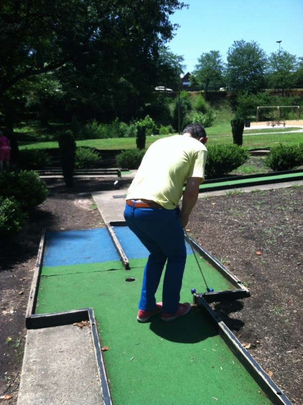 Mr. Tee putts across fake water, aka blue turf.
