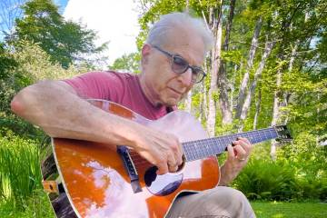 Happy Traum picking a Santa Cruz Guitar Company Happy Traum Signature Model HT/13 at his home in Woodstock, NY
