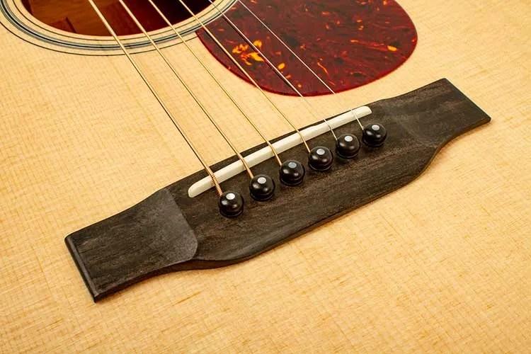 Collings 001 14-Fret acoustic guitar bridge close up