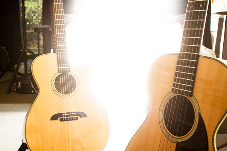 Two acoustic guitars with bright light