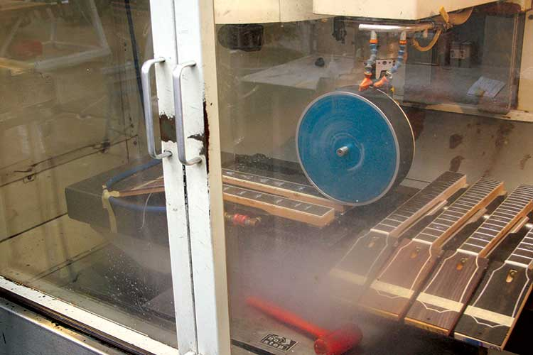 CNC machine in the Taylor Guitars factory making acoustic guitar necks