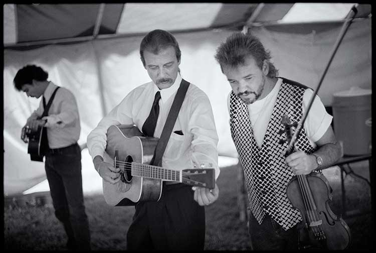 Wyatt Rice, Tony Rice, and Rickie Simpkins in Gettysburg, PA, 1994, before Tony took the stage and sang for the last time.