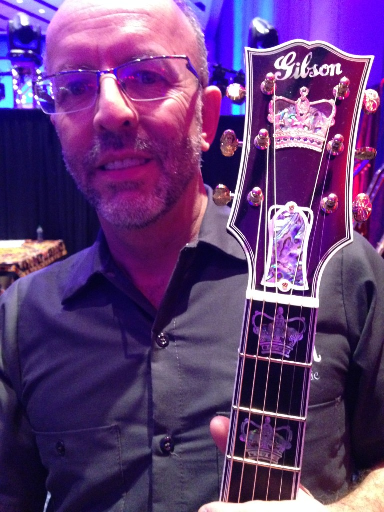 Don Ruffatto shows off that headstock