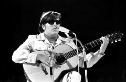 jose feliciano holding a nylon-string guitar