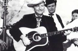 gnutarist Lester Flatt flatpicking with acoustic guitar