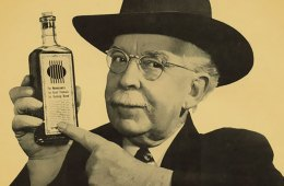 old-time photo of a snake oil salesman