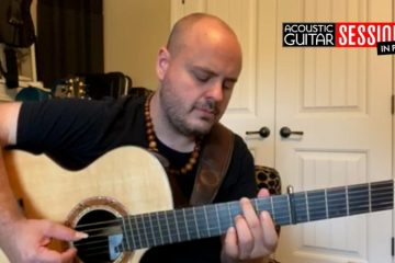Andy McKee playing acoustic guitar