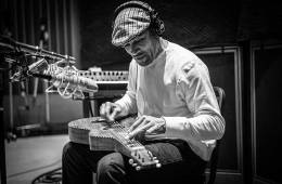 Ben Harper playing slide guitar in studio