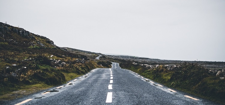 photograph of an asphalt road on a gray day in ireland