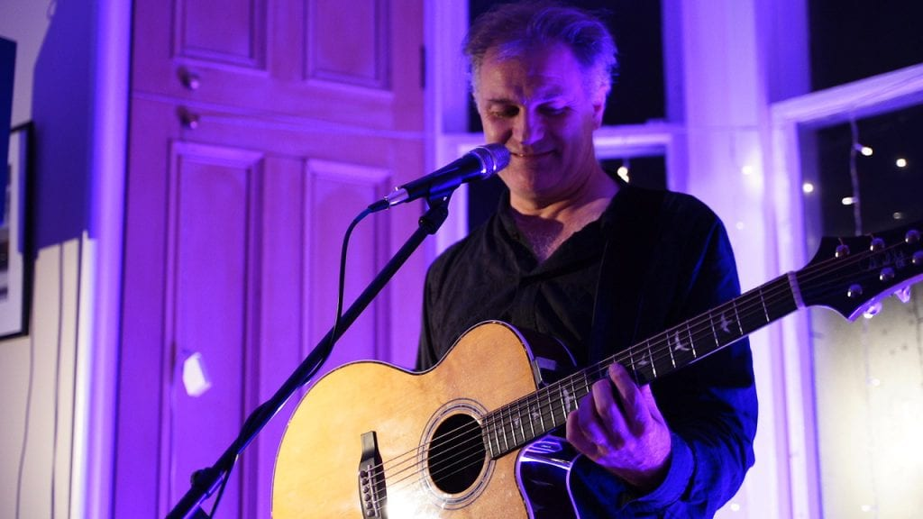Nick Harper playing a house concert in Glasgow