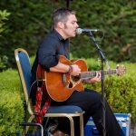 Mark Graham playing at a wedding outdoors