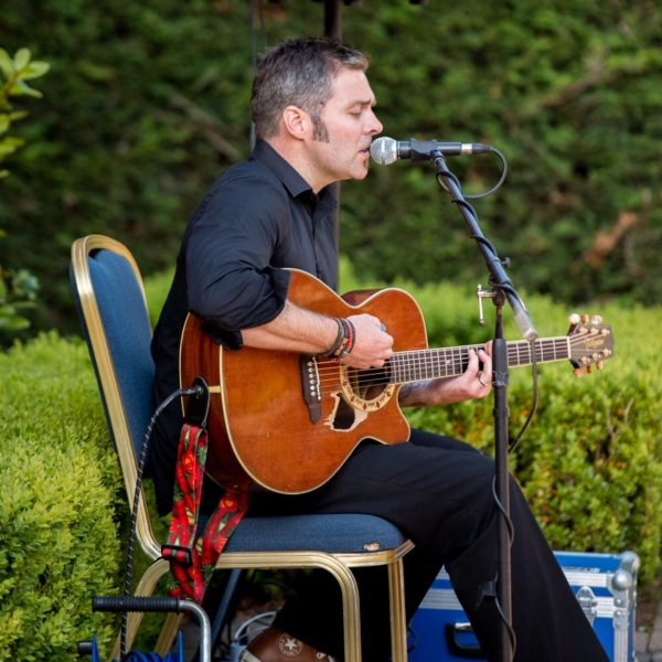 Mark Graham playing at a wedding outdoors