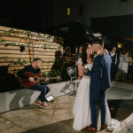 Mark playing as the Bride and Groom dance