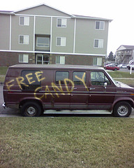 "A van with ""free candy"" painted on its side"