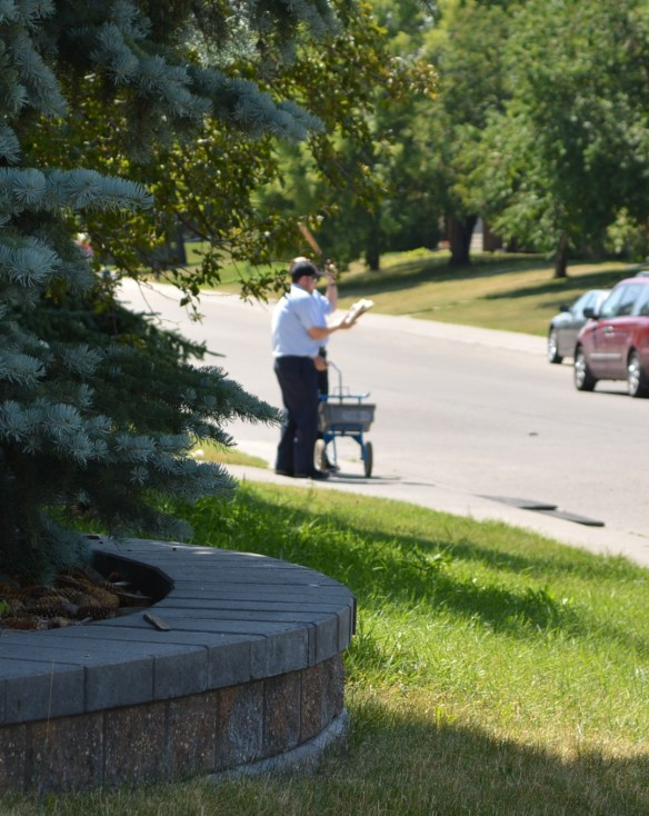 Canada Post Worker With Baseball Bat 3