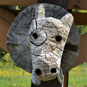 Wood carving of cow's head