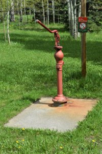 Red, rusted handpump for drinking water