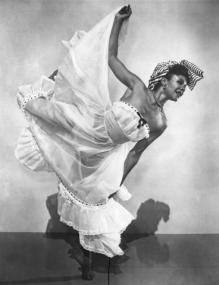 "Though not a classical ballerina in the strictest sense, Katherine Dunham was a wide-ranging and groundbreaking figure in the dance world. From the African American Registry: Born in Chicago, Dunham received her bachelor's, master's, and doctoral degrees in anthropology from the University of Chicago and later did extensive anthropological study, particularly in the Caribbean. She began performing in 1931 in Chicago and then worked for the New York Labor Stage, where she composed dances for ""The Emperor Jones,"" ""Pins and Needles,"" and ""Run, Li'l Chillun."" In 1936, Dunham received a Julius Rosenwald Foundation fellowship, with which she traveled and studied dance in the West Indies, particularly in Haiti. In 1940, she formed a highly acclaimed all-Black dance troupe that toured her works in the United States and in Europe. She also choreographed for, and performed in, motion pictures and Broadway musicals. Dunham opened the Dunham School of Dance in New York City, which trained dancers in classical ballet, African and Caribbean dance forms, anthropology, and other cultural arts. The school was an influential center of Black dance. She became the first Black choreographer at the Metropolitan Opera in New York City."