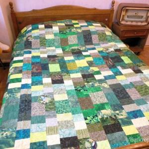 Acropatch-Couvre-lit-2-places-fil-uni-vert-sur un lit en 140 cm