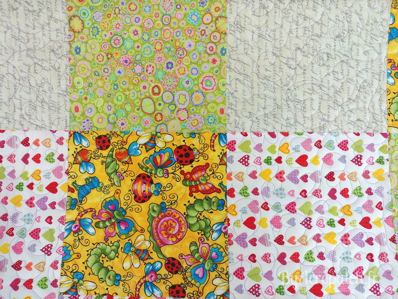 Acropatch-Baby-Quilt-Box1-Motif-Quilting-I-love-you-fil-uni-parme-91x113cm-portion après le quiltage