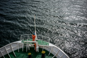 You know we're sailing out of calm fiords into the open sea when they take the flag down.