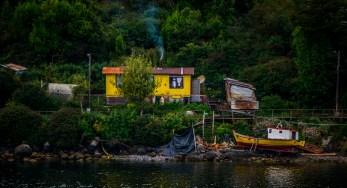Local inhabitant of Puerto Eden. Notice the tv satelite dish out the back.