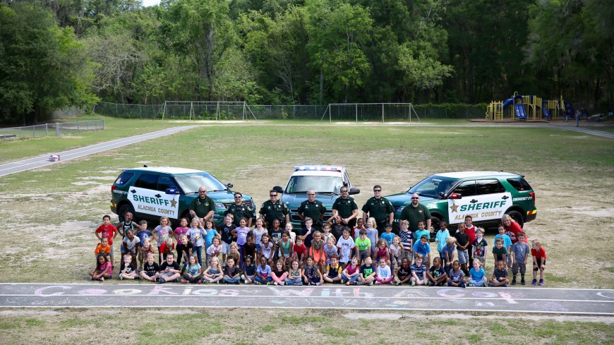 Alachua County School Resource Deputies and Kids at a Cookies With A Cop event at their school
