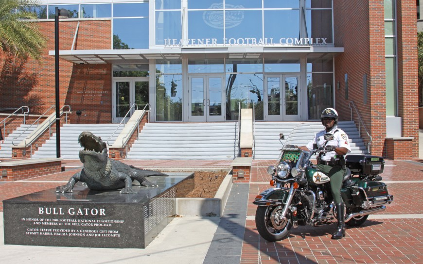 Alachua County Sheriff's Office Motor Unit Deputy at Florida Field next to the Bull Gator statue
