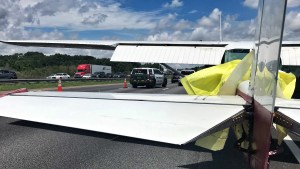 Deputies directing traffic around a plane that landed on I-75