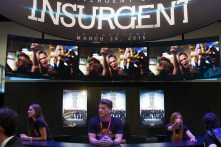 Staff prepares for giveaways at the Lionsgate booth.