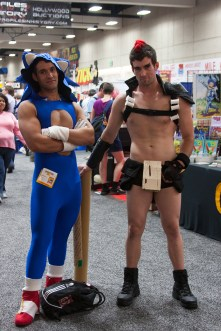 Cosplayers dress as Sonic the Hedgehog and a Nudist Beach warrior from 'Kill la Kill.'