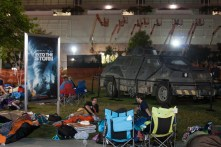 Campers sit next to a vehicle from Warner Bros.' 'Into the Storm.'