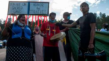 Treaty Defenders Arrested for Blocking Road to Trump's Mount Rushmore Event 10