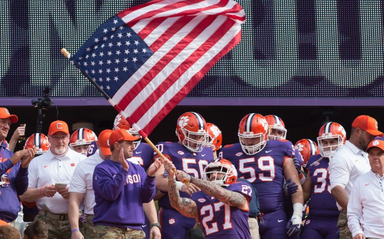 Clemson Tigers wave the American Flag