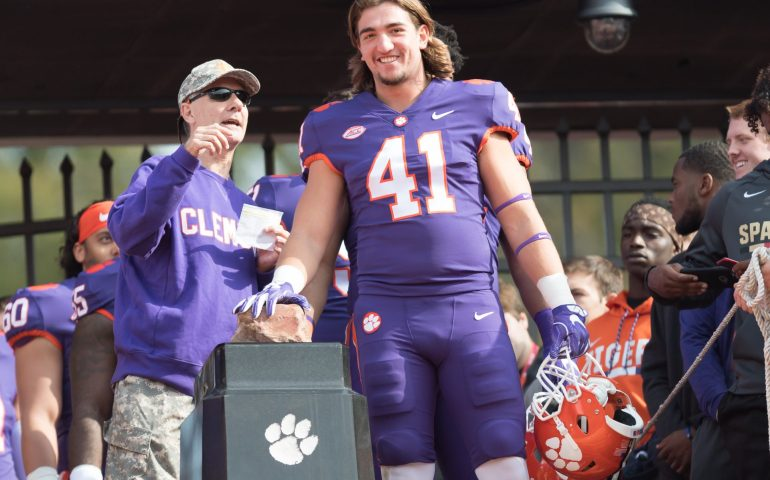 Clemson Defender rub Howard's Rock with a big smile