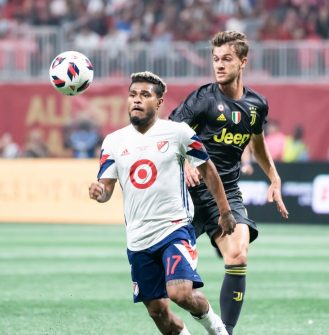 Josef Martinez determined to win ball against Juventus in MLS All-Star game.