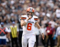 Baker Mayfield quiets the crowd after a great run against the Atlanta Falcons