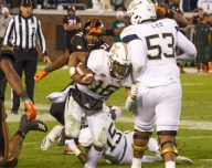 Taquan Marshall advances the ball against the Miami Hurricanes