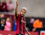 osef Martinez points to the crowd celebrating a score