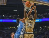 Abdoulaye Gueye Georgia Tech Yellow Jackets Forward makes a slam against the North Carolina Tarheels