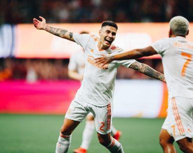 Escobar and Josef Martinez celebrate after scoring a goal vs Minnesota