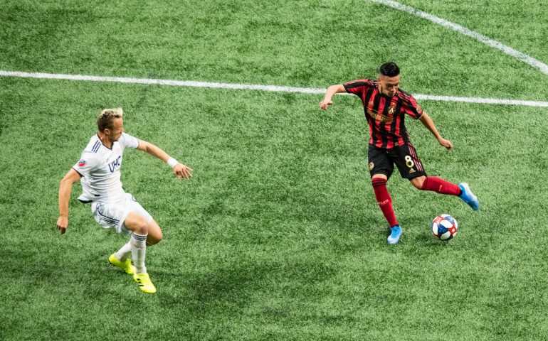 Ezequiel Barco attempts a shot at goal against New England in the first round of the 2019 MLS playoffs