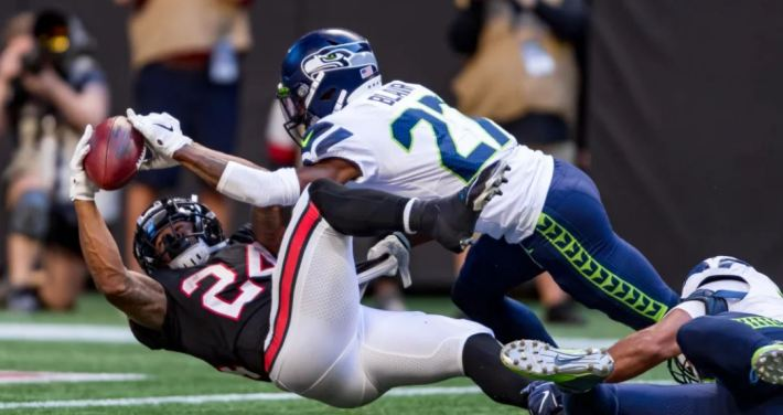Devonta Freeman fumbles the ball stretching out to score a touchdown