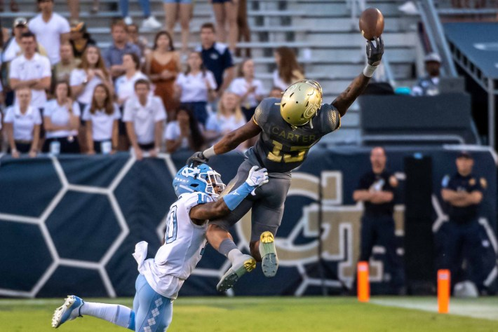 Malachi Carter makes an attempt to catch a pass versus UNC Tarheels  #togetherweswarm, #404theculture, #yellowjackets, #Georgiatech
