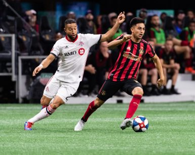 Pity Martinez runs away from a Toronto FC defender during the 2019 Eastern Conference Final