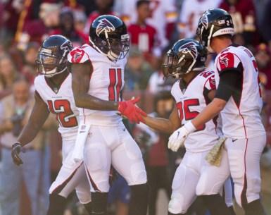 Julio Jones celebrates with teammates