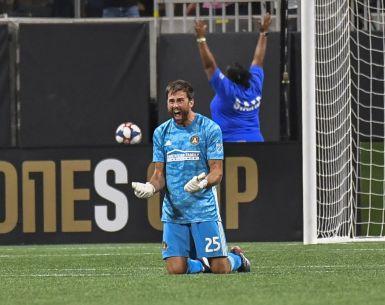 Alec Kann celebrates Atlanta United's win in Campeones Cup vs. Club America