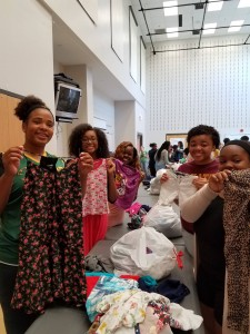 "About 50 Enloe High School students sorted more than 90 bags of donated clothing for Note in the Pocket in just under an hour, learning how clothing children with ""love and dignity"" is important."