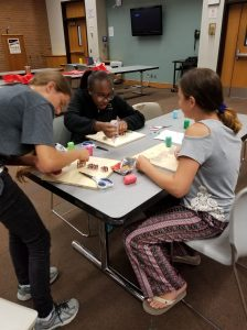 Brainstorming their ideas!